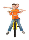 Boy and girl on bicycle on white royalty free stock images