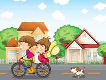 A boy and a girl biking followed by a dog. Illustration of a boy and a girl biking followed by a dog Royalty Free Stock Image