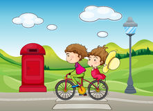 A boy and a girl biking Stock Image