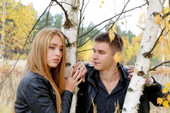 Boy and girl at a birch Stock Photography