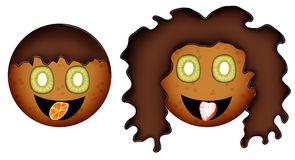 Boy and girl of biscuits. This boy and girl of biscuits. They smile. Their eyes are made of kiwi. Their hair is made of chocolate. Their tongues are made of Royalty Free Stock Images