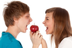 Boy and a girl biting the apple Stock Photo