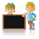 A Boy and a Girl with a blackboard. At school Royalty Free Stock Photography