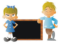 A Boy and a Girl with a blackboard Stock Photo