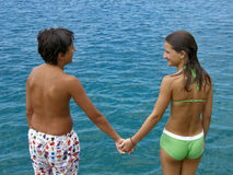 Boy and girl on blue Adriatic sea Stock Photo