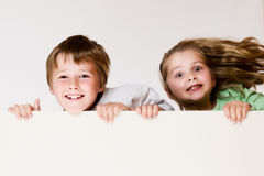 Boy and girl with board Royalty Free Stock Images