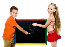 Boy and girl with a board Stock Image