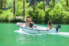 Boy and girl in boat Stock Images