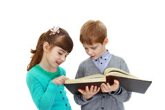 Boy and girl with book Royalty Free Stock Photos