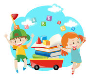Boy and girl with books on wagon Stock Photo