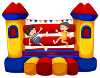 Boy and girl bouncing on the funhouse Stock Images