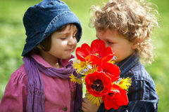 Boy and girl with bouquet of flowers Royalty Free Stock Photo