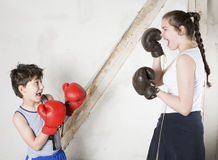 Boy and girl boxing Stock Image