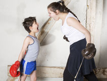 Boy and girl boxing Stock Images