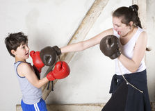 Boy and girl boxing Royalty Free Stock Images