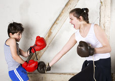 Boy and girl boxing Stock Photos