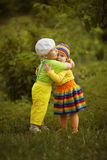 Boy with a girl in bright colored clothing stock photography