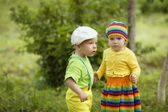 Boy with a girl in bright colored clothing Royalty Free Stock Image