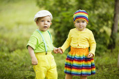 Boy with a girl in bright colored clothing royalty free stock photography