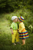 Boy with a girl in bright colored clothing Stock Photos