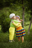 Boy with a girl in bright colored clothing Royalty Free Stock Images