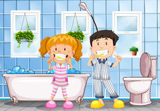 Boy and girl brushing teeth in the bathroom Stock Photography