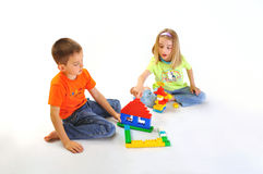 Boy and girl building house Stock Photo