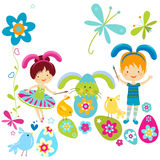 Boy and girl in bunny costume. Painting the easter eggs Stock Photography