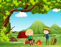 Boy and girl camping out in the field Stock Images