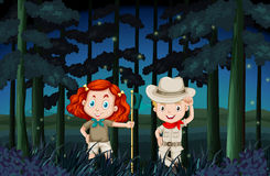 Boy and girl camping out at night Royalty Free Stock Image