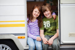 Boy And Girl In A Caravan Stock Image