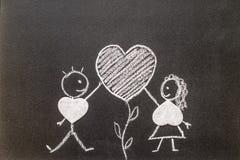 Boy and girl on chalkboard. Sweet love Stock Photography