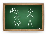 Boy and girl on chalkboard Royalty Free Stock Photos