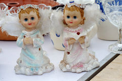 Boy and girl cherub statuettes flea market Stock Images