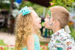 The boy and girl child with aqua make-up on happy birthday. Celebration concept and childhood, love Stock Photos