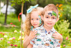 The boy and girl child with aqua make-up on happy birthday. Celebration concept and childhood, love Stock Photo