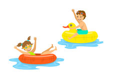 Boy and girl, children floating on inflatable rings Royalty Free Stock Photos