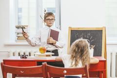 Boy, girl children in the school has a happy royalty free stock photo