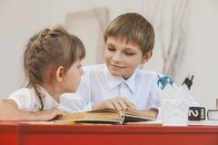 Boy, girl children in the school has a happy, curious stock images