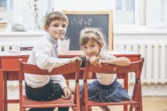 Boy, girl children in the school has a happy royalty free stock photos