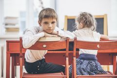 Boy, girl children in the school has a happy stock photos
