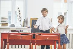 Boy, girl children in the school has a happy stock photography