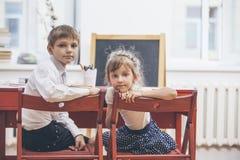 Boy, girl children in the school has a happy stock photo