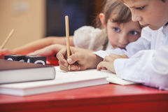 Boy, girl children in the school has a happy, curious, smart stock photos