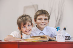 Boy, girl children in the school has a happy, curious, smart Royalty Free Stock Images