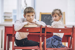 Boy, girl children in the school has a happy, curious, smart Royalty Free Stock Photo