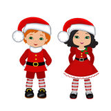 Boy and Girl with Christmas Costume. Royalty Free Stock Images