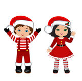 Boy and Girl with Christmas Costume. Stock Photo