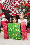 Boy and girl with Christmas gifts Royalty Free Stock Photography