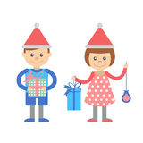 Boy and girl with Christmas gifts. Royalty Free Stock Image